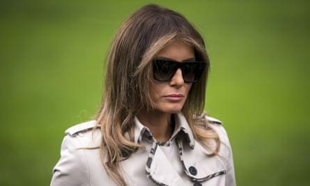 Melania Trump is shades and raincoat