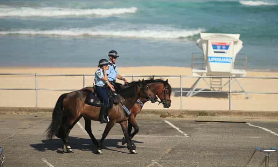 Police on horseback patrol Bondi beach in Sydney