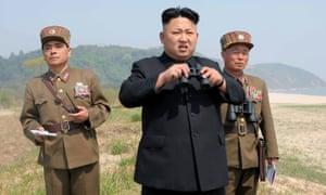 North Korean leader Kim Jong-un watches a rocket-launching drill.
