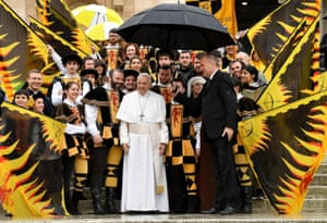 Pope Francis poses during the weekly general audience in St Peter's Square, Vatican City