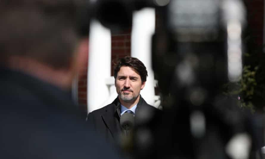 The Canadian prime minister, Justin Trudeau, speaks during a news conference on the Covid-19 situation from his residence in Ottawa where he is self-isolating on Monday.