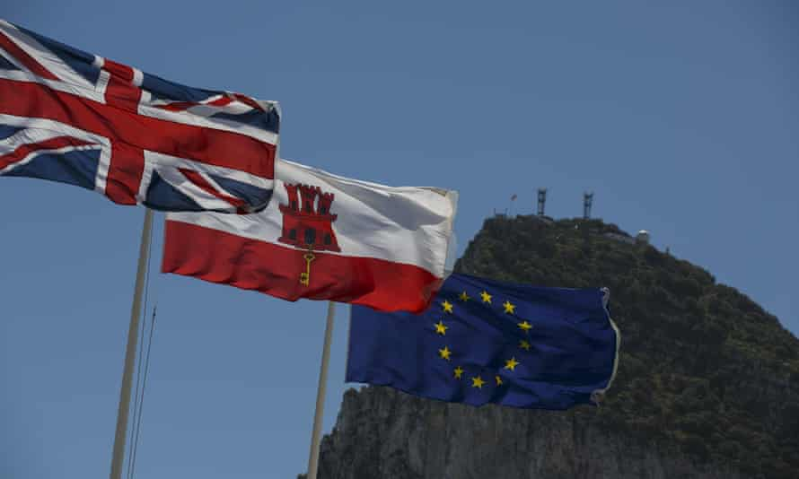 Flags of the United Kingdom, Gibraltar and the European Union are flown with Gibraltar in the background
