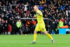 Bournemouth keeper Aaron Ramsdale celebrates victory after the final whistle goes.