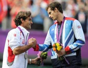 2012: Roger Federer shakes hands with the victorious Murray during the medals ceremony after the men's singles gold medal match at the London 2012 Olympics.