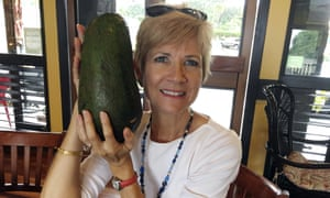 Pamela Wang poses with an avocado she found while on a walk in Hawaii. Wang is waiting to hear back from Guinness World Records if it is the world's largest.