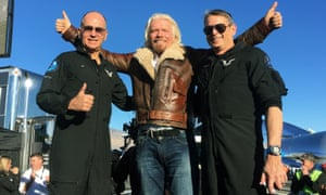 "Richard Branson, center, celebrates with pilots Rick ""CJ"" Sturckow, left, and Mark ""Forger"" Stucky, right"