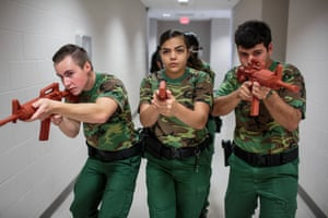 """Students practice a room clearing drill in the Border Patrol Explorer Program, Kingsville, Texas At the US Border Patrol Station in Kingsville, Texas, students use the """"Virtu 300"""" reality program, which helps train individuals in law enforcement in real-life scenarios with active shooters. The Explorer program is for students aged 14-20, and is sponsored by the Boy Scouts and Homeland Security"""