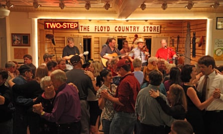 A crowd dances in front of a bluegrass band playing at  Floyd Country Store, Floyd, Virginia.