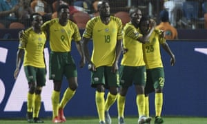 South Africa's players congratulate Thembinkosi Lorch (right) after he opened the scoring in the dying minutes.
