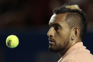 Australia's Nick Kyrgios tosses a ball in the air as he waits to serve