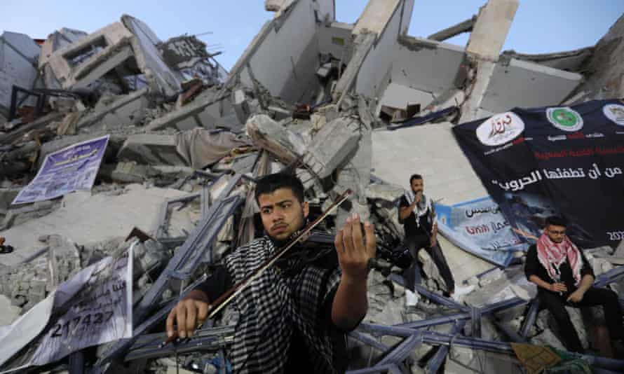 Palestinian musicians perform in ruins