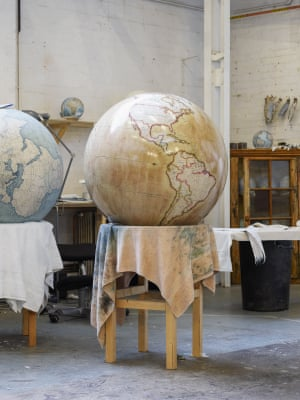 A globe that has been painted dries on a stand at Bellerby & Co, north London, UK.