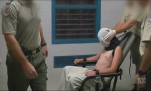A teenage boy being hooded and restrained at Don Dale Juvenile detention centre in the Northern Territory,