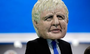 A masked actor portraying Boris Johnson in the Oxfam Big Heads event at the UN Climate Change Conference COP25 in Madrid.