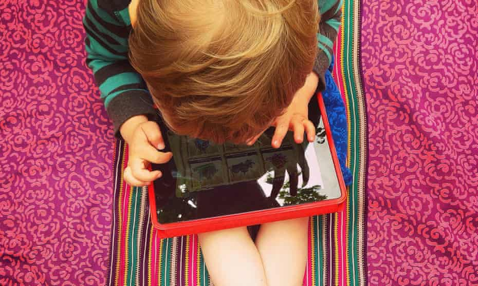 Young Boy playing on a Tablet