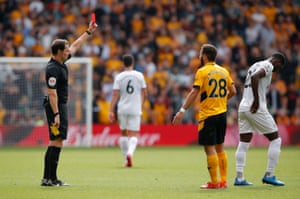 Brentford's Shandon Baptiste is shown a red card by referee Darren England.