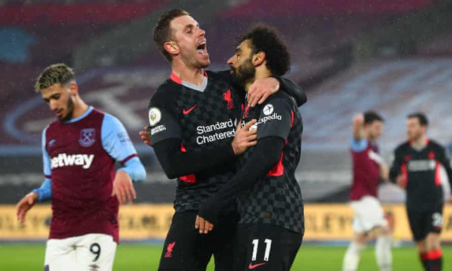 The Liverpool captain, Jordan Henderson, celebrates with Mohamed Salah after the Egyptian's superb second goal in a 3-1 win against West Ham.