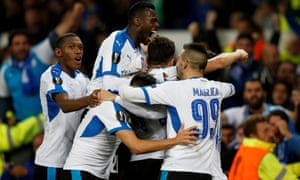The Apollon Limassol players are jubilant after Hector Yuste headed in the equaliser.