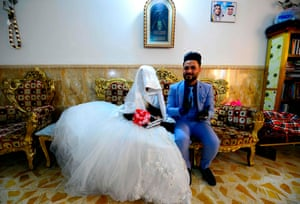 Najaf, Iraq: a couple prepare to get married as authorities impose restrictions on large gatherings in a bid to stem the spread of Covid-19