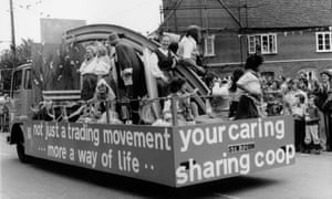 More than just economics: staff from the Co-op shop in Tollesbury, Essex, join with members of the Co-operative folk dance club to parade a float down the street.