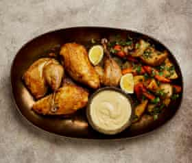 Yotam Ottolenghi's roast poached chicken with whipped garlic.
