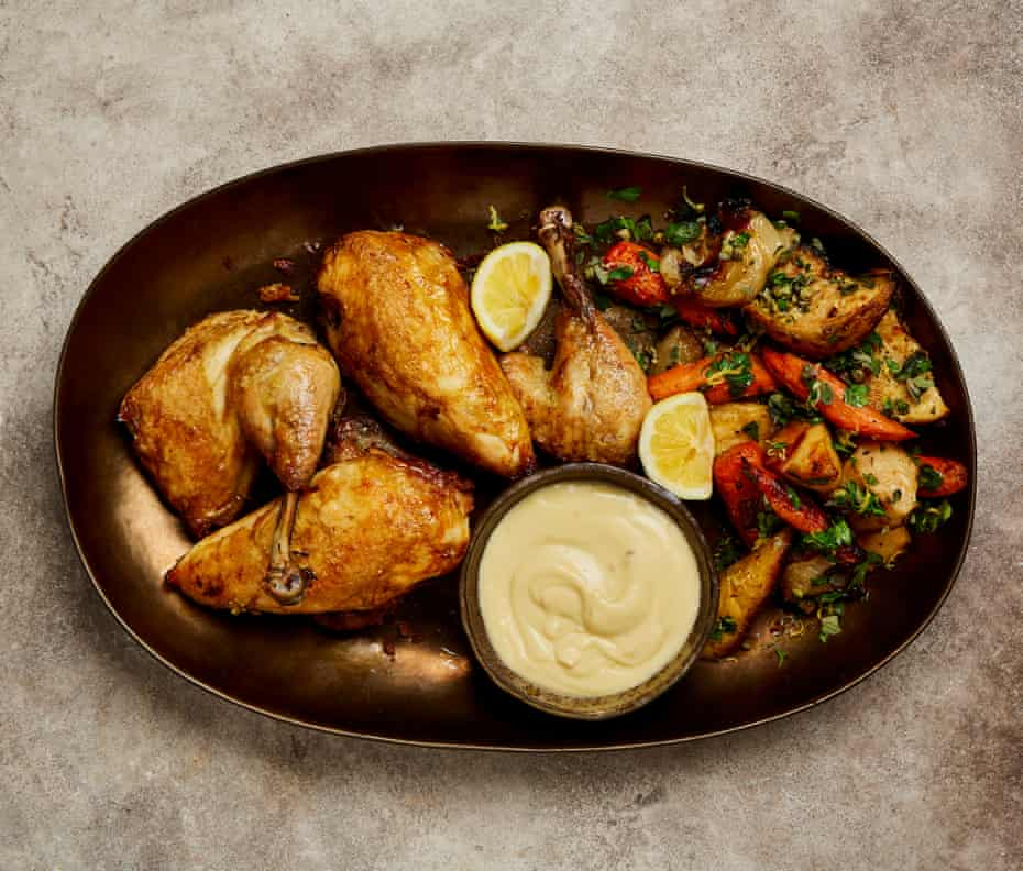 Yotam Ottolenghi's thrifty roast poached chicken with whipped garlic.
