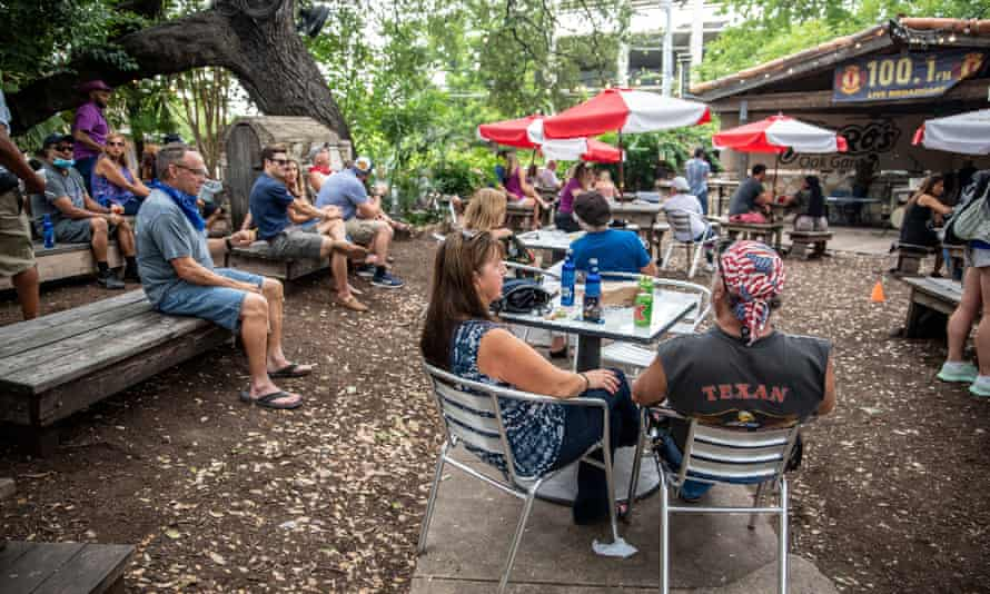 People sit al fresco at a bar and restaurant in Austin, Texas, on 28 June.