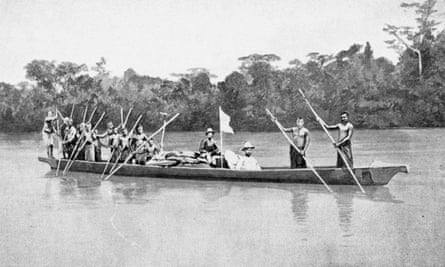 Mary Kingsley photographed in her expedition canoe on the Ogooué River in 1895.