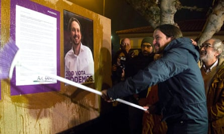 Podemos leader Pablo Iglesias sticks an election poster prior to his party's first rally campaign in Villaralbo, northern Spain.
