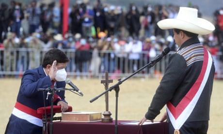 Peru's president, Pedro Castillo, swears in Guido Bellido (left) as his prime minister