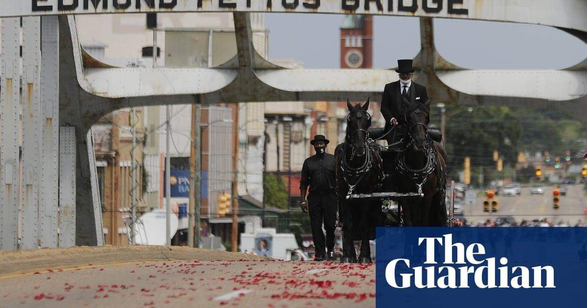 John Lewis crosses Edmund Pettus Bridge in Selma for final time – The Guardian