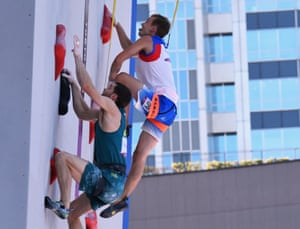 Tom O'Halloran of Australia and Michael Piccolruaz of Italy in action in the sport climbing.