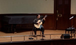 Sean Shibe on stage at an empty Wigmore Hall