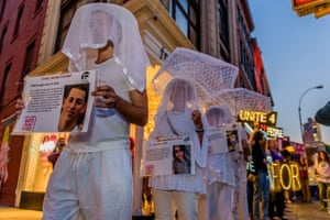 People wearing veils take part in an anti-gun march from Union Square Park to Times Square in New York City