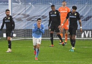 Manchester City's Joao Cancelo reacts after his shot hit the bar.