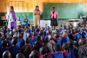 Head teacher Maureen Masi listens as the first lady addresses Chipala's pupils at an assembly.