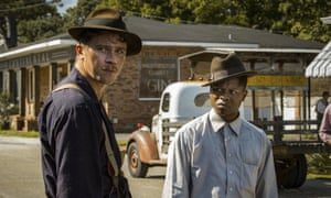 Garrett Hedlund, left, and Jason Mitchell in a scene from Mudbound, directed by Dee Rees.