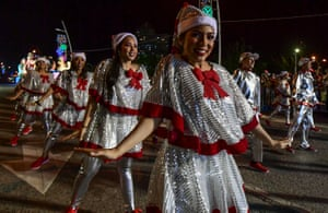 Revellers and musicians perform during a Christmas parade in Panama City, Panama