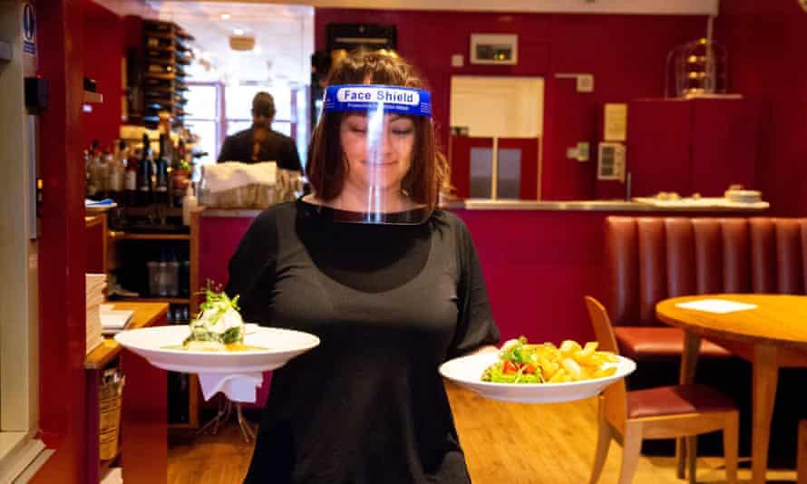 A restaurant waitress at work in Brighton.
