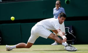 Djokovic slides to make a return on his way to a straight sets victory over Tomic.