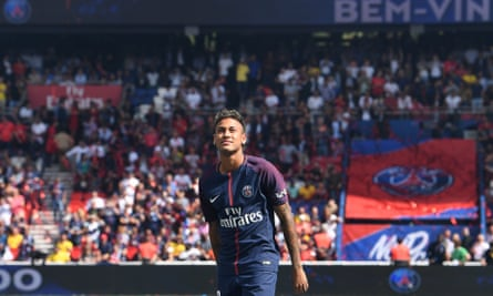 Neymar looks up at the Parc des Princes crowd as he is presented before Paris Saint-Germain's first game of the season.