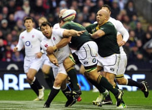 England's prop Alex Corbisiero is tackled by South Africa's flanker Willem Alberts