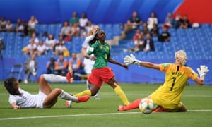 Ajara Nchout of Cameroon scores her team's first goal.