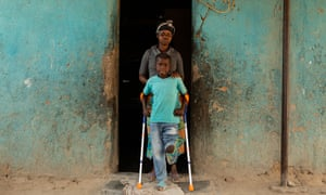 Manuel Rodriguez with his mother Ermelinda Victoria Jaime. Manuel lost one of his legs when a landmine exploded as he played with friends.