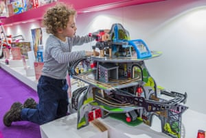 A young boy plays with the Mighty Mountain Mine by Marbel