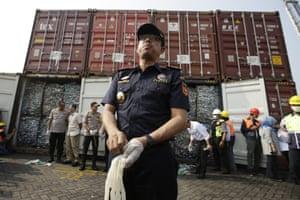 Customs chief Heru Pambudi shows reporters containers full of plastic waste at Tanjung Priok port, in Jakarta, Indonesia