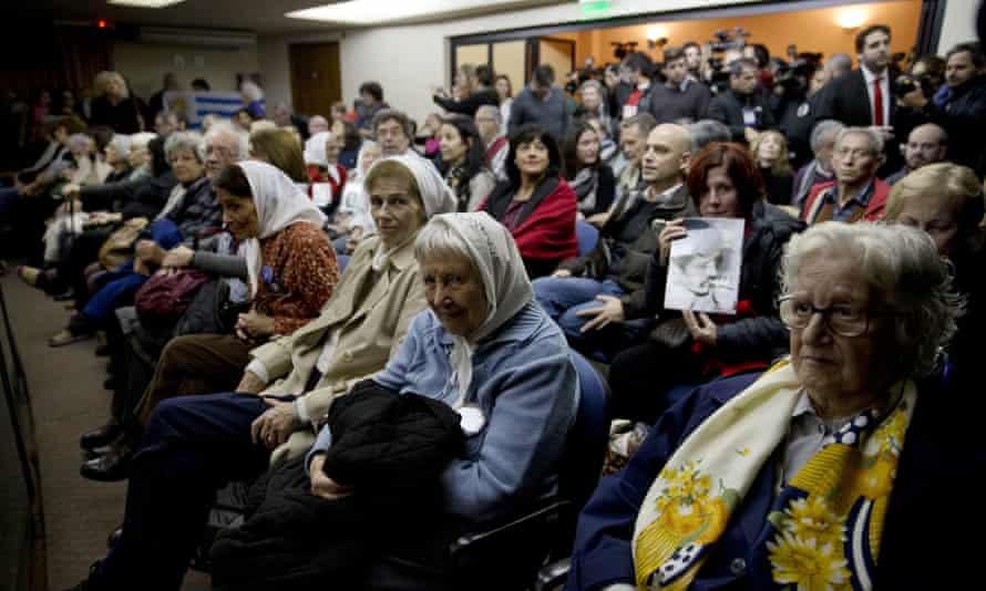 Families of victims sitting in court for the sentencing of former military officers in Buenos Aires.