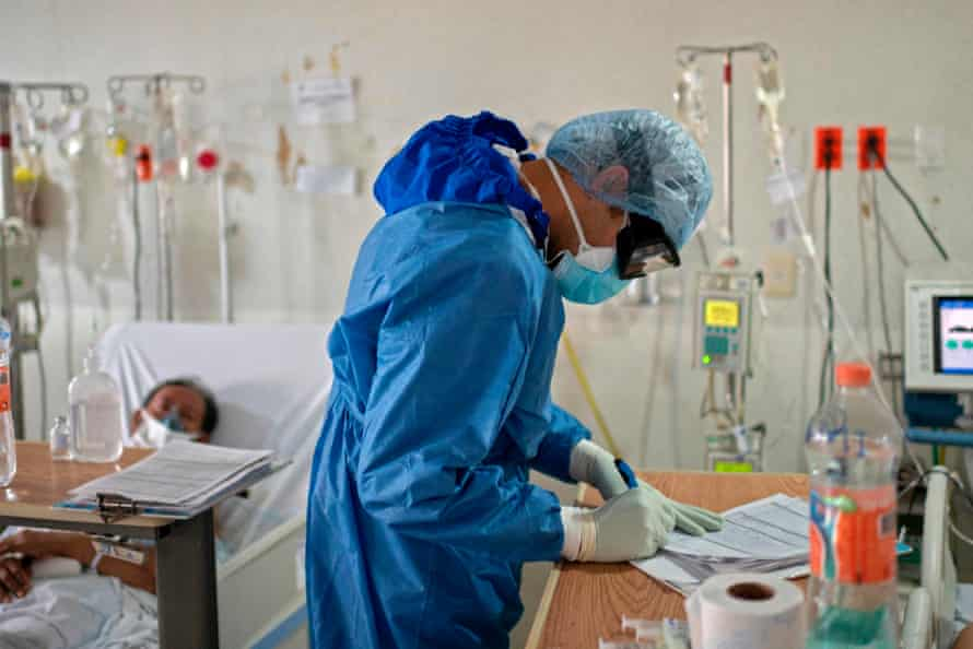 A doctor fills in paperwork for a Covid-19 patient in May 2020.