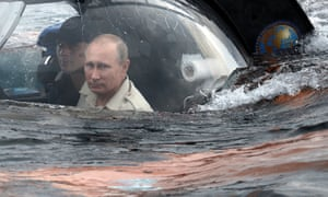 No signs of second thoughts: Vladimir Putin on board the submersible as it goes beneath the surface near Sevastopol