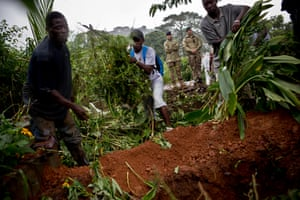 A safe burial team at work in a graveyard in Freetown, Sierra Leone